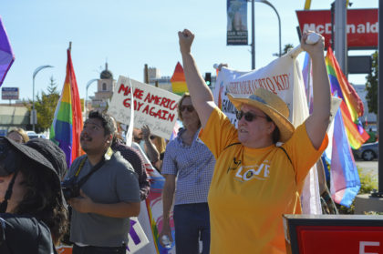SUUS Member raises a clenched fist for LGBTQ acceptance